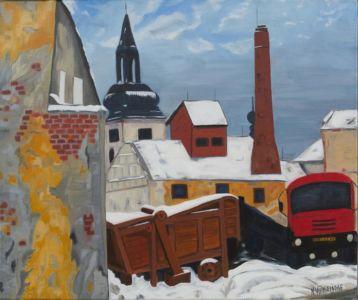 Escena rural de un pueblo centroeuropeo bajo la nieve.