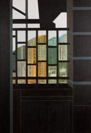 Un vistazo desde la ventana, mirando a la ciudad en un día gris.