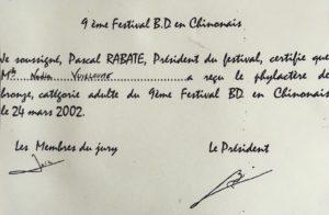 """Phylactère de bronze pour : """"Perfection Destructrice"""" remis par Pascal Rabaté, auteur de bande dessinée"""