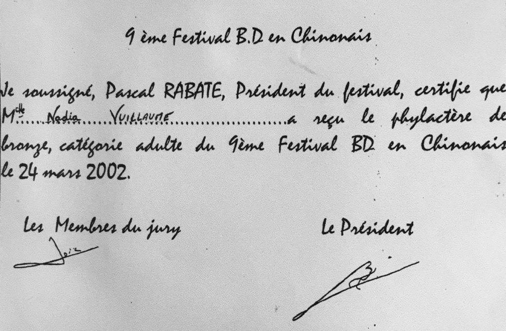 """Phylactère de bronze pour : """"Perfection destructrice"""", en 2002"""